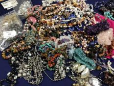 A mixed lot of mainly hardstone pebble and bead necklaces together with miscellaneous bangles