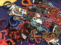 A mixed lot of beads, bangles and pendants, many set hardstone, polished pebble etc. (a lot)