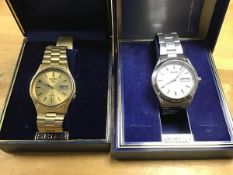 Two cased Seiko gentleman's wristwatches; a gold plated automatic wristwatch on gold plated strap (