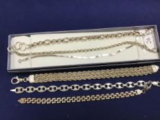 A group of white metal bracelets and chains, including a three strand rope fancy link bracelet (