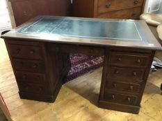 A 19thc/20thc. oak twin pedestal knee hole desk, the rectangular top with inset leather skiver,