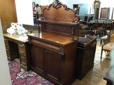 A Victorian chiffonier, the carved back with open shelf raised on turned supports, the rectangular