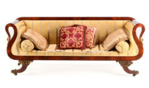 A REGENCY SOFA Cuban mahogany, arms ending in gilded swans heads. Silk lined. Zoomorphic bronze feet