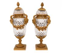 A PAIR OF LOUIS XVI COVERED URNS Faceted and engraved crystal, ormolu mounts with fauns and grape