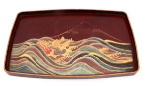 A JAPANESE TRAY Lacquered wood, gilt decoration depicting sea with dragon and vulcano. Japan,