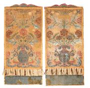 A PAIR OF ITALIAN CLOTHES Profusely embroided, depicting vases and foliage. Blue velvet bases on red