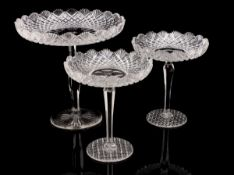 THREE CENTRE PIECES Cut-crystal, possibly Baccarat. Height: 21 cm and 26 cm. Diam.: 18.5 cm and 25.5