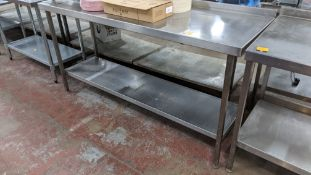 Stainless steel twin tier table with top measuring approximately 1790mm x 600mm