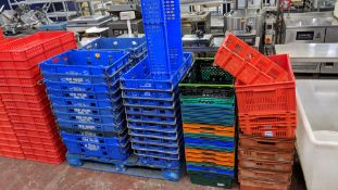 Large quantity of assorted plastic crates in 5 stacks. NB some of the crates have markings indicati