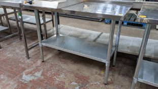 Stainless steel twin tier table, top measuring approximately 1220mm x 610mm