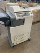 HP ColorSphere Color LaserJet multifunction printer model CM4730MFP. Pedestal includes 3 large mult