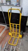 Yellow sack truck with fold up footplate & pneumatic tyres