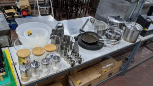 The contents of a table comprising jars, bowls, sugar dispensers, milk jugs, trays, strainers, pans