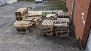 11 stacks of pallets, including regular size, euros, odd sizes and damaged. Approx 9-10 pallets per