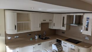 L-shaped kitchen comprising white/cream floor and wall units with Compac labelled granite (or simila
