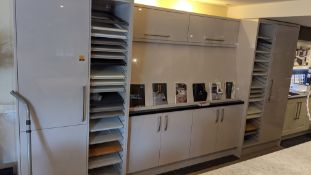 Large display unit in pale grey laminate including contents of assorted samples. This cupboard arran