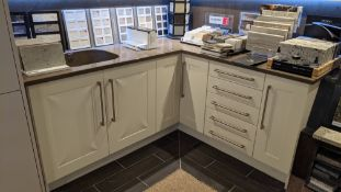 L-shaped kitchen arrangement comprising base cupboards, Silestone counter within integrated basin pl