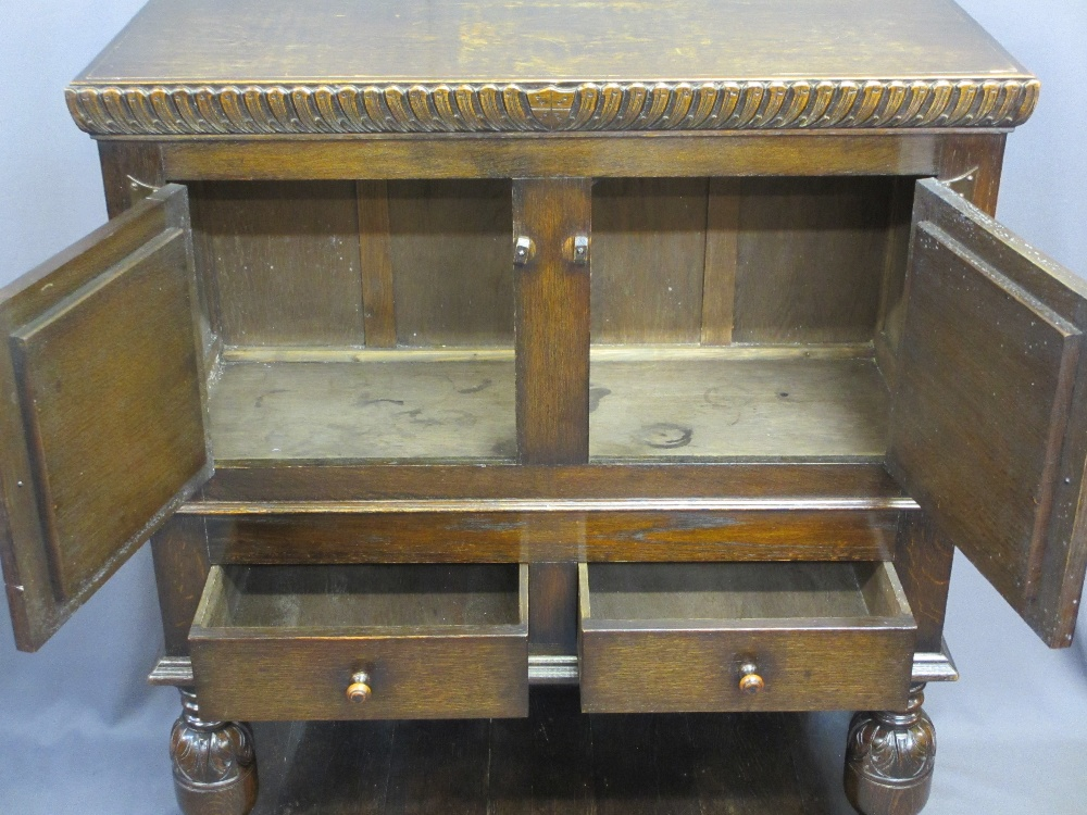 Lot 29 - VINTAGE CONTINENTAL CARVED OAK BUFFET SIDEBOARD having twin upper doors with bird and mask detail