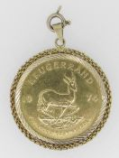 1974 1OZ GOLD KRUGERRAND IN 9CT GOLD MOUNT, 38 grams overall. Condition Report: In good overall