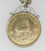 1980 1/2OZ GOLD KRUGERRAND IN 9CT GOLD MOUNT on 9ct gold chain. 27 grams overall. Condition