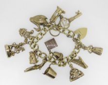 18CT GOLD CURB LINK CHARM BRACELET HAVING HEART SHAPED PADLOCK and an assortment of mainly 9ct