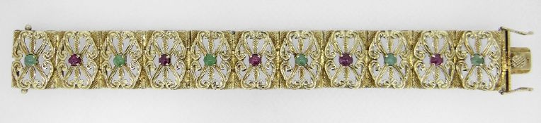 14K YELLOW GOLD SCROLL AND FLORAL TABLET BRACELET, each tablet with alternating rubies and green