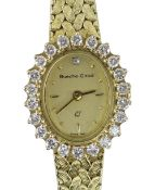 9CT YELLOW GOLD LADIES BUECHE-GIROD COCKTAIL WATCH, the oval dial surrounded by twenty-two