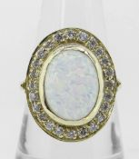 14K (585) YELLOW GOLD OVAL OPAL DRESS RING having border of twenty-four small diamonds, 6.8 grams.