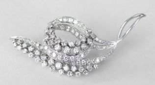WHITE METAL DIAMOND ENCRUSTED LEAF AND SCROLL DESIGN BROOCH, 6.4cms at widest point, 12.9 grams.