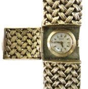 LADIES 9CT YELLOW GOLD GRUEN OF GENEVE WRISTWATCH, the circular dial behind a hinging escapement