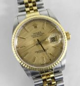 ROLEX OYSTER PERPETUAL DATEJUST SUPERLATIVE CHRONOMETER WRISTWATCH, having baton hands and numerals,