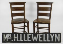 ITEMS RELATING TO LT COL SIR HARRY LLEWELLYN CBE comprising a pair of oak chapel chairs from his