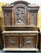 IMPRESSIVE 19TH CENTURY FLEMISH WALNUT CABINET, arched top with carved doors divided by fluted