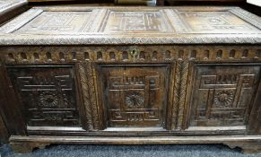 18TH CENTURY JOINED OAK COFFER, later carved with rosettes and foliate uprights, later bracket feet,