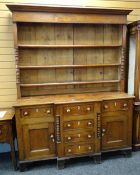 19TH CENTURY ANGLESEY WELSH DRESSER, the base with flanking cupboards and six drawers, on bracket