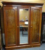 VICTORIAN MAHOGANY TRIPLE WARDROBE, arched panel doors and replaced mirror centre, 178cms wide x