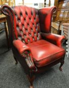 VINTAGE BUTTONED RED LEATHER WING-BACK ARM CHAIR Condition Report: arms and back worn leather.