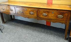 18TH CENTURY ELM OAK DRESSER BASE, three deep frieze drawers and carved apron, square section