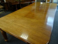 GEORGE IV MAHOGANY EXTENDING DINING TABLE on fluted, reeded corner and centre supports with brass