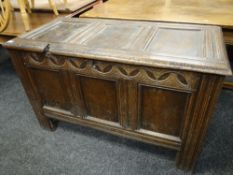 18TH CENTURY OAK COFFER with lunette carved frieze and moulded uprights, 119cms wide
