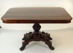 WILLIAM IV FLAME MAHOGANY BREAKFAST TABLE, rectangular tilt action top, on elaborate carved column