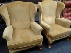 PAIR OF REPRODUCTION GEORGIAN-STYLE WING-BACK ARMCHAIRS on carved ball and claw supports, caramel