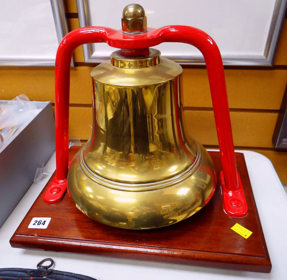 Lot 264 - BRASS FIRE STATION BELL suspended on a red painted frame to a rectangular wooden mount, bell diam.