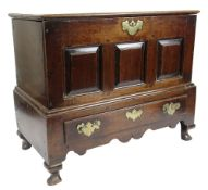 GEORGE II OAK COFFER BACH detachable lid with moulded edge, above triple fielded panel front over