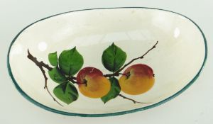 RARE LLANELLY POTTERY GONDOLA SHAPED BOWL painted with two apples on a branch, 25cms Condition