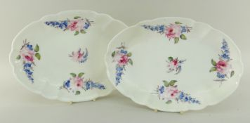 PAIR OF NANTGARW PORCELAIN OVAL CRUCIFORM DISHES both painted with groups of blue flowers and pink