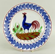 A LLANELLY COCKEREL PLATE typically decorated with sponged leaves to the border, believed to have