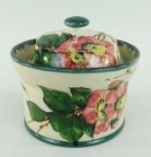 LLANELLY POTTERY PRESERVE POT & COVER painted with briar roses, of circular form with everted rim