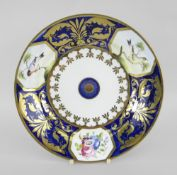 A SWANSEA PORCELAIN PLATE attributed to William Pollard, painted with three panels of birds on