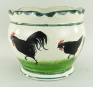 RARE LLANELLY POTTERY JARDINIERE painted with seven strutting black cocks on sponged grass, lobed
